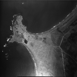Aerial view of Tyre, including the original island towards the left, the continental coast to the right and the tombolo that links them together in the middle (photograph: Poidebard archives at the Univeriste Saint Joseph).